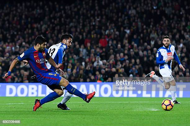 Luis Suarez of FC Barcelona scores the opening goal during the La Liga match between FC Barcelona and RCD Espanyol at the Camp Nou stadium on...