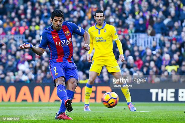 Luis Suarez of FC Barcelona scores the opening goal during the La Liga match between FC Barcelona and UD Las Palmas at Camp Nou stadium on January 14...
