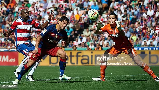 Luis Suarez of FC Barcelona scoring his team's second goal during the La Liga match between Granada CF and FC Barcelona at Estadio Nuevo Los Carmenes...