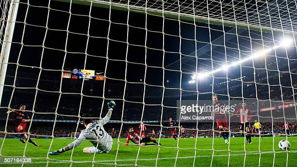 Luis Suarez of FC Barcelona shoots the ball past Iago Herrerin and scores his team's first goal during the Copa del Rey Quarter Final Second Leg...