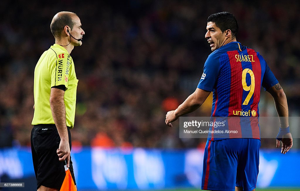 Luis Suarez of FC Barcelona talks with the referee during La Liga match between FC Barcelona and Real Madrid CF at Camp Nou Stadium on December 3...
