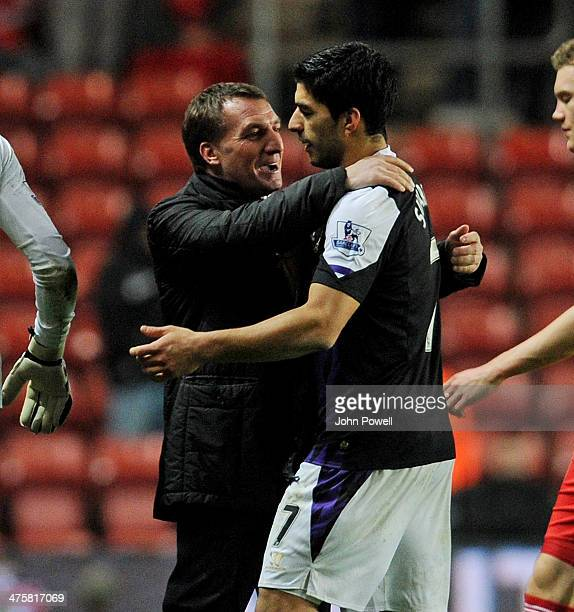 Luis Suarez of Liverpool and Brendan Rodgers manager of Livertpool share a joke at the end of the Barclays Premier Leauge match between Southampton...
