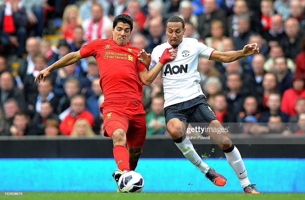 Luis Suarez of Liverpool and <a gi-track='captionPersonalityLinkClicked' href=/galleries/search?phrase=Rio+Ferdinand&family=editorial&specificpeople=157538 ng-click='$event.stopPropagation()'>Rio Ferdinand</a> of Manchester United compete during the Barclays Premier League match between Liverpool and Manchester United at Anfield on September 23, 2012 in Liverpool, England.