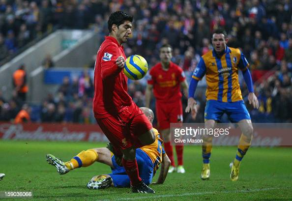 Luis Suarez of Liverpool appears to control the ball with his hand during the FA Cup with Budweiser Third Round match between Mansfield Town and...