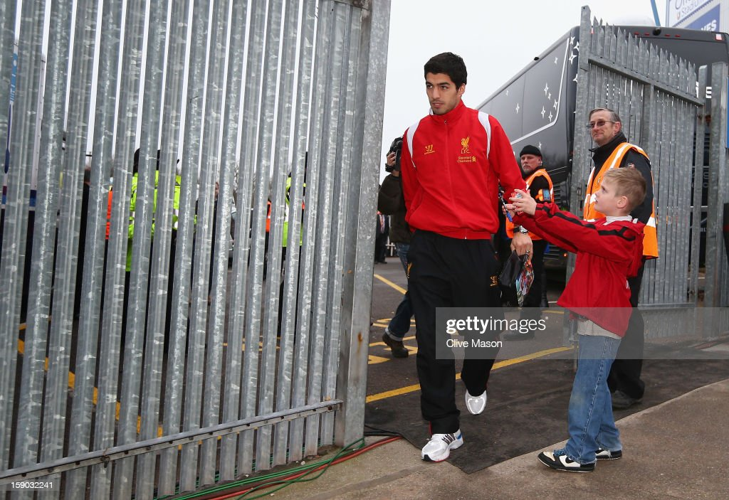 Luis Suarez of Liverpool arrives at the ground prior to the FA Cup with Budweiser Third Round match between Mansfield Town and Liverpool at One Call Stadium on January 6, 2013 in Mansfield, England.
