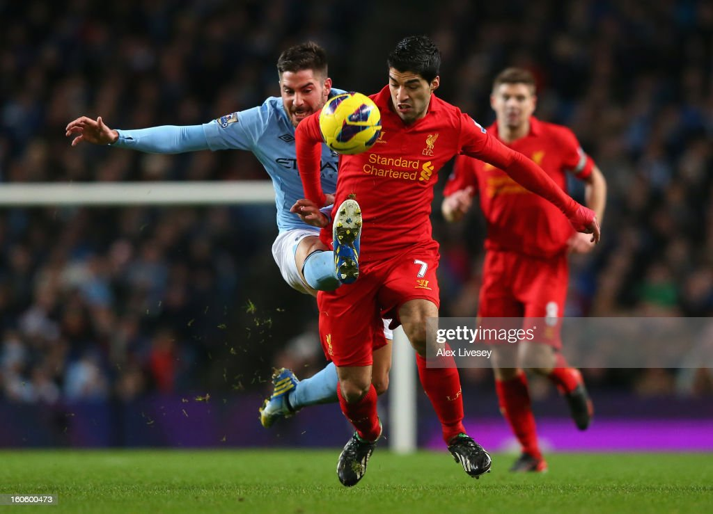 Luis Suarez of Liverpool battles for the ball with Javi Garcia of Manchester City during the Barclays Premier League match between Manchester City and Liverpool at the Etihad Stadium on February 3, 2013 in Manchester, England.