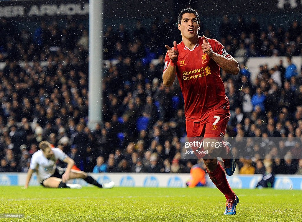 Luis Suarez of Liverpool celebrates after scoring a goal during the Barclays Premier Leauge match between Tottenham Hotspur and Liverpool at White Hart Lane on December 15, 2013 in London, England.