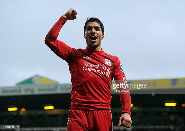 Luis Suarez of Liverpool celebrates after scoring his hattrick during the Barclays Premier League match between Norwich City and Liverpool at Carrow...