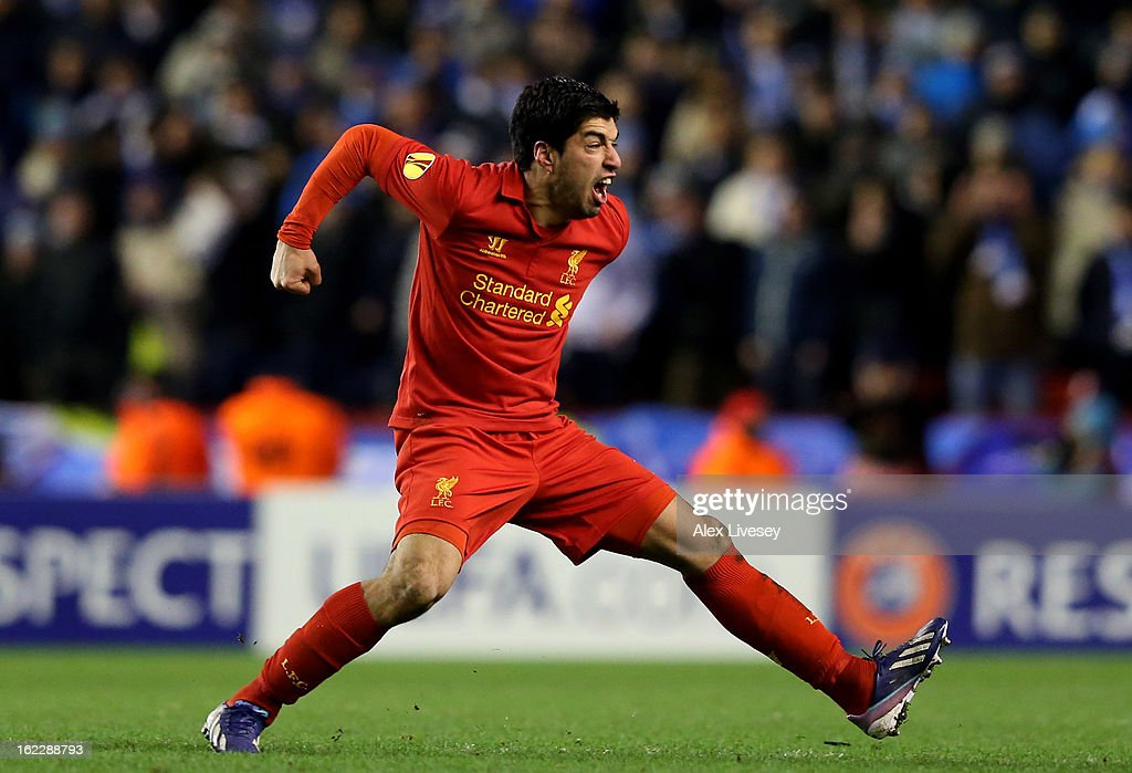 Luis Suarez of Liverpool celebrates after scoring his team's third goal from a free kick during the UEFA Europa League round of 32 second leg match between Liverpool FC and FC Zenit St Petersburg at Anfield on February 21, 2013 in Liverpool, England.