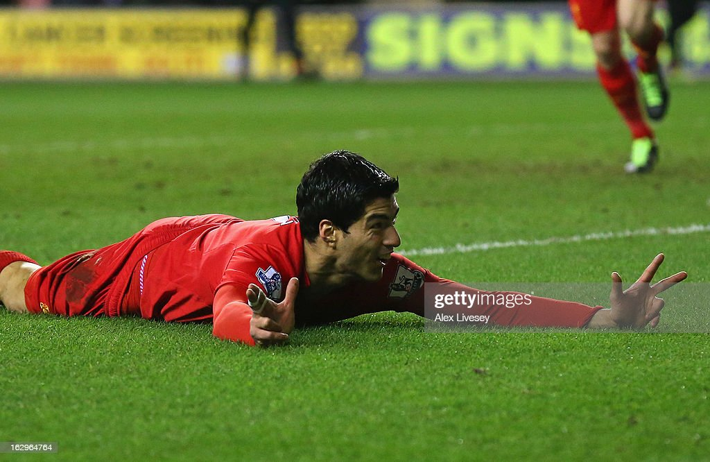 Luis Suarez of Liverpool celebrates after scoring his third goal to complete a hat trick during the Barclays Premier League match between Wigan Athletic and Liverpool at the DW Stadium on March 2, 2013 in Wigan, England.