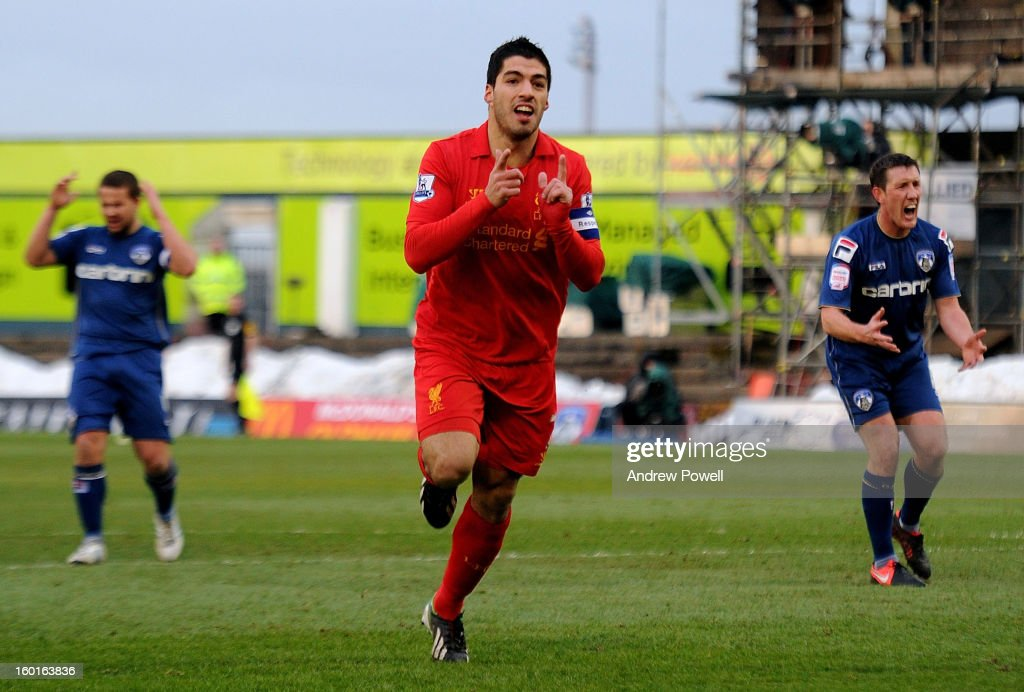Luis Suarez of Liverpool celebrates after scoring the equlising goal during the FA Cup Fourth Round match between Oldham Athletic and Liverpool at Boundary Park on January 27, 2013 in Oldham, England.