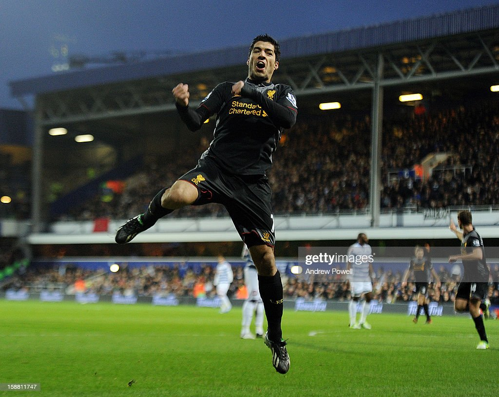 Luis Suarez of Liverpool celebrates after scoring the opening goal during the Barclays Premier League match between Queens Park Rangers and Liverpool at Loftus Road on December 30, 2012 in London, England.