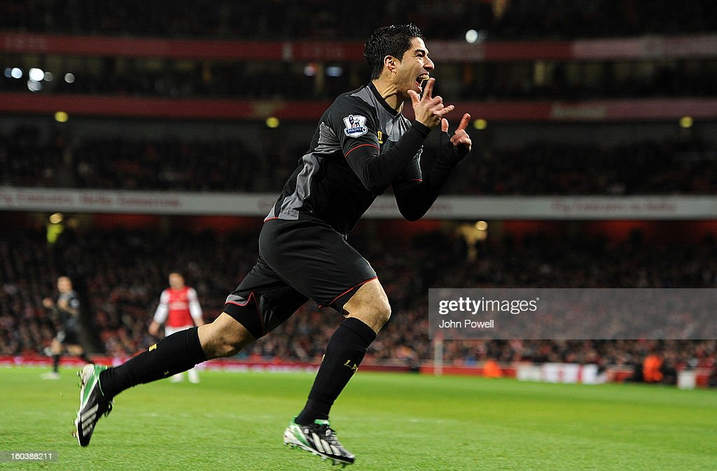 Luis Suarez of Liverpool celebrates after scoring the opening goal during the Barclays Premier League match between Arsenal and Liverpool at Emirates Stadium on January 30, 2013 in London, England.