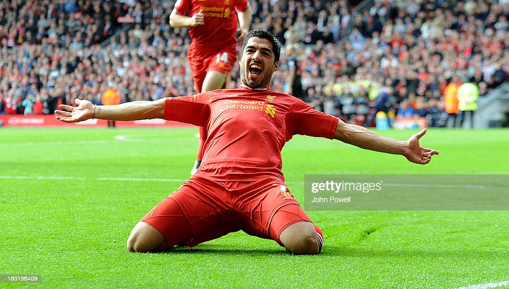 Luis Suarez of Liverpool celebrates after scoring the opening goal during the Barclays Premier League match between Liverpool and Crystal Palace at Anfield on October 5, 2013 in Liverpool, England.