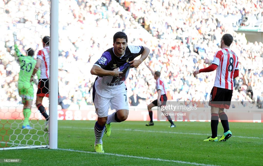 Luis Suarez of Liverpool celebrates after scoring the second goal during the Barclays Premier League match between Sunderland and Liverpool at Stadium of Light on September 29, 2013 in Sunderland, England.