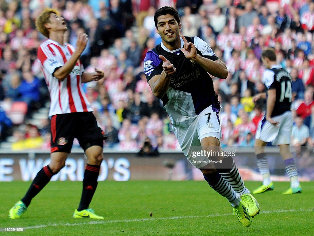 Luis Suarez of Liverpool celebrates after scoring the third goal during the Barclays Premier League match between Sunderland and Liverpool at Stadium of Light on September 29, 2013 in Sunderland, England.