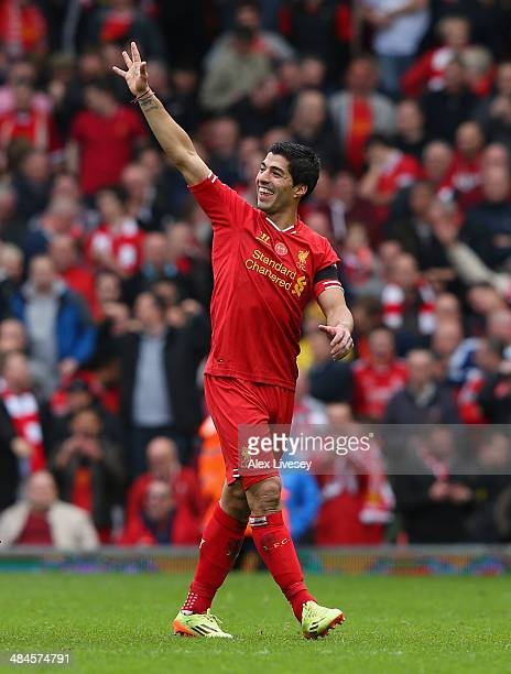Luis Suarez of Liverpool celebrates at the end of the Barclays Premier League match between Liverpool and Manchester City at Anfield on April 13 2014...