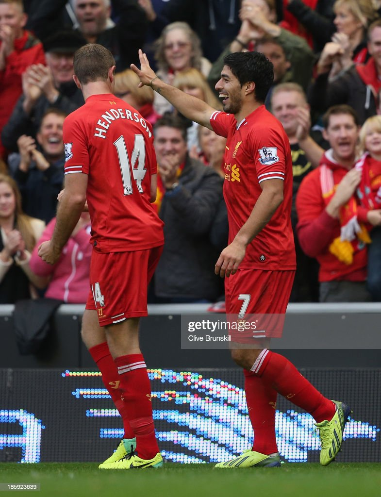 Luis Suarez of Liverpool celebrates completing his hat-trick during the Barclays Premier League match between Liverpool and West Bromwich Albion at Anfield on October 26, 2013 in Liverpool, England.