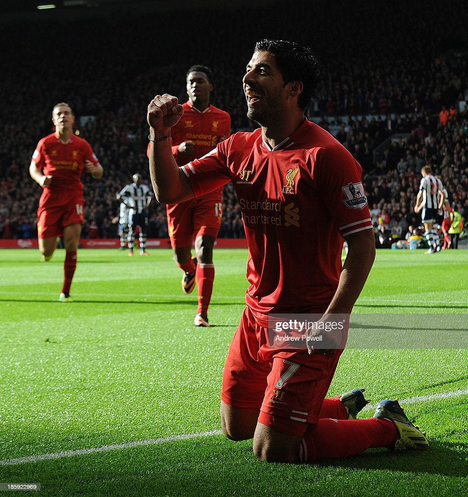 Luis Suarez of Liverpool celebrates his first goal during the Barclays Premier League match between Liverpool and West Bromwich Albion at Anfield on October 26, 2013 in Liverpool, England.