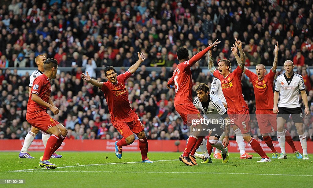 Luis Suarez of Liverpool celebrates his first goal during the Barclays Premier League Match between Liverpool and Fulham at Anfield on November 9, 2013 in Liverpool, England.