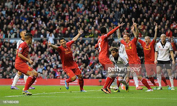 Luis Suarez of Liverpool celebrates his first goal during the Barclays Premier League Match between Liverpool and Fulham at Anfield on November 9...