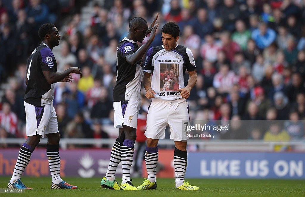 Luis Suarez of Liverpool celebrates his first goal with <a gi-track='captionPersonalityLinkClicked' href=/galleries/search?phrase=Mamadou+Sakho&family=editorial&specificpeople=4154099 ng-click='$event.stopPropagation()'>Mamadou Sakho</a> and <a gi-track='captionPersonalityLinkClicked' href=/galleries/search?phrase=Kolo+Toure&family=editorial&specificpeople=204364 ng-click='$event.stopPropagation()'>Kolo Toure</a> (L) during the Barclays Premier League match between Sunderland and Liverpool at the Stadium of Light on September 29, 2013 in Sunderland, England.