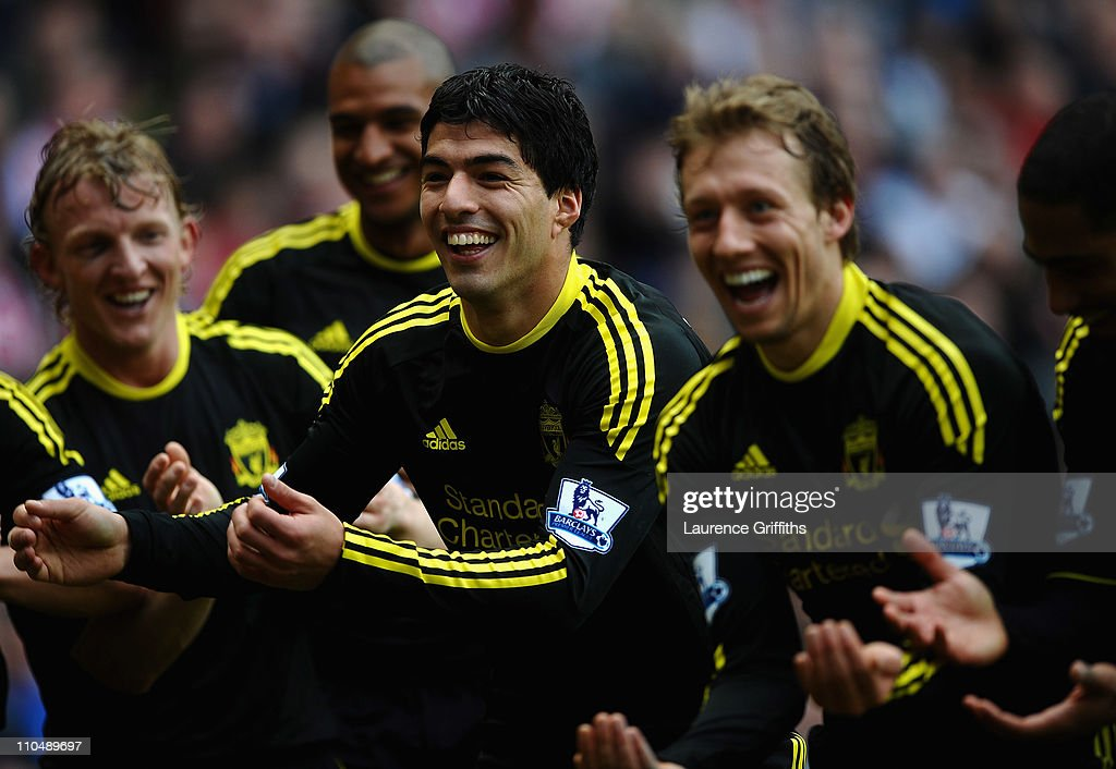 Luis Suarez of Liverpool (2ndr) celebrates his goal alongside Lucas Leiva, <a gi-track='captionPersonalityLinkClicked' href=/galleries/search?phrase=Dirk+Kuyt&family=editorial&specificpeople=538141 ng-click='$event.stopPropagation()'>Dirk Kuyt</a> and <a gi-track='captionPersonalityLinkClicked' href=/galleries/search?phrase=Raul+Meireles&family=editorial&specificpeople=605369 ng-click='$event.stopPropagation()'>Raul Meireles</a> during the Barclays Premier League match between Sunderland and Liverpool at the Stadium of Light on March 20, 2011 in Sunderland, England.