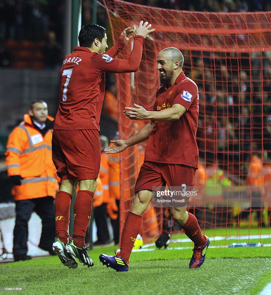 Luis Suarez of Liverpool celebrates his goal during the Barclays Premier League match between liverpool and Fulham at Anfield on December 22, 2012 in Liverpool, England.