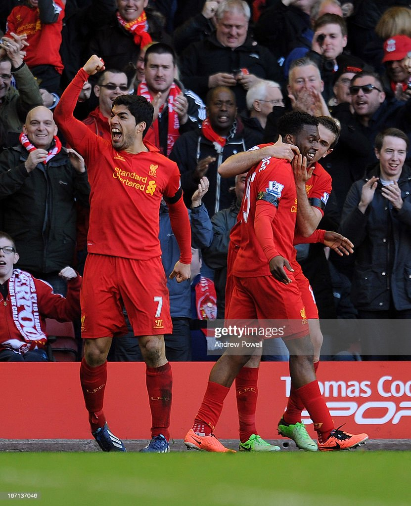 Luis Suarez of Liverpool celebrates his goal to make it 2-2 during the Barclays Premier League match between Liverpool and Chelsea at Anfield on April 21, 2013 in Liverpool, England.