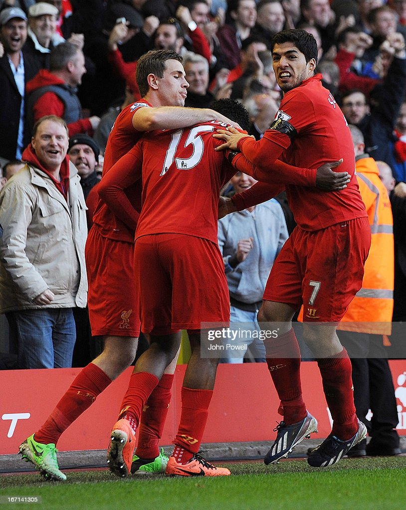 Luis Suarez (R) of Liverpool celebrates his goal to make it 2-2 during the Barclays Premier League match between Liverpool and Chelsea at Anfield on April 21, 2013 in Liverpool, England.