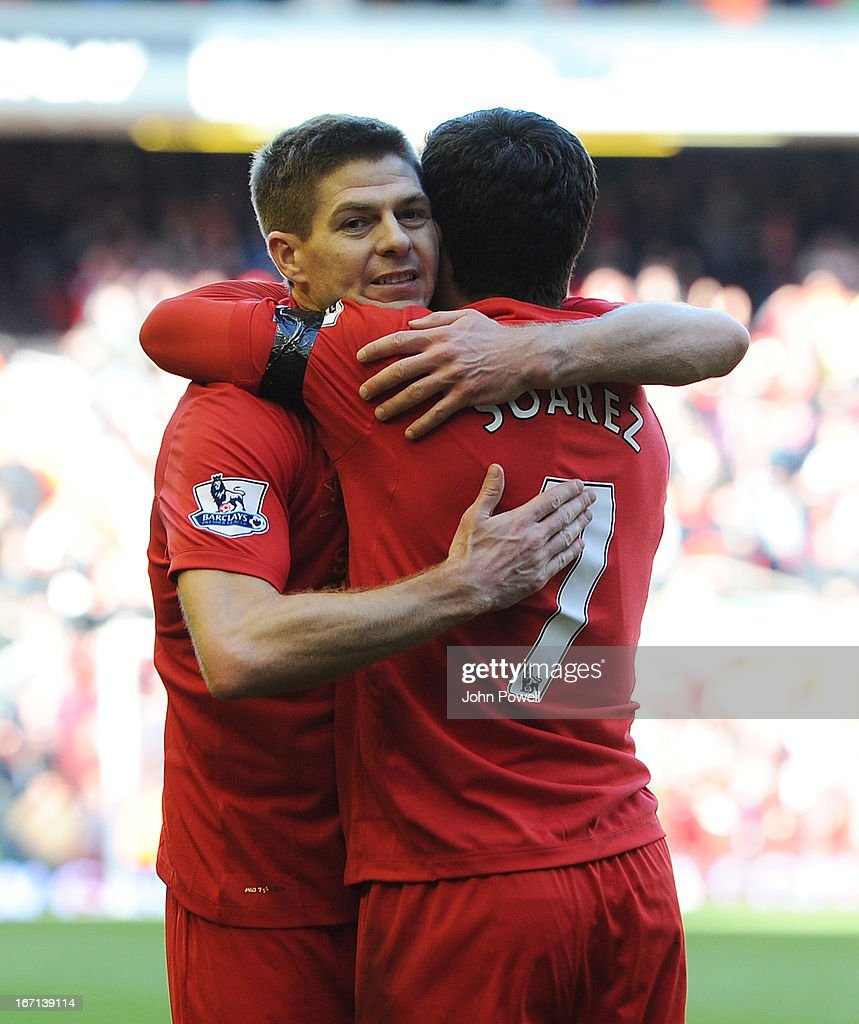 Luis Suarez of Liverpool celebrates his goal to make it 2-2 with Steven Gerrard during the Barclays Premier League match between Liverpool and Chelsea at Anfield on April 21, 2013 in Liverpool, England.