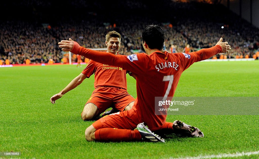 Luis Suarez of Liverpool celebrates his goal with Steven Gerrard during the Barclays Premier League match between Liverpool and Sunderland at Anfield on January 2, 2013 in Liverpool, England.