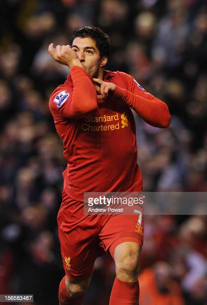 Luis Suarez of Liverpool celebrates his second goal during the Barclays Premier League match between Liverpool and Wigan Athletic at Anfield on...