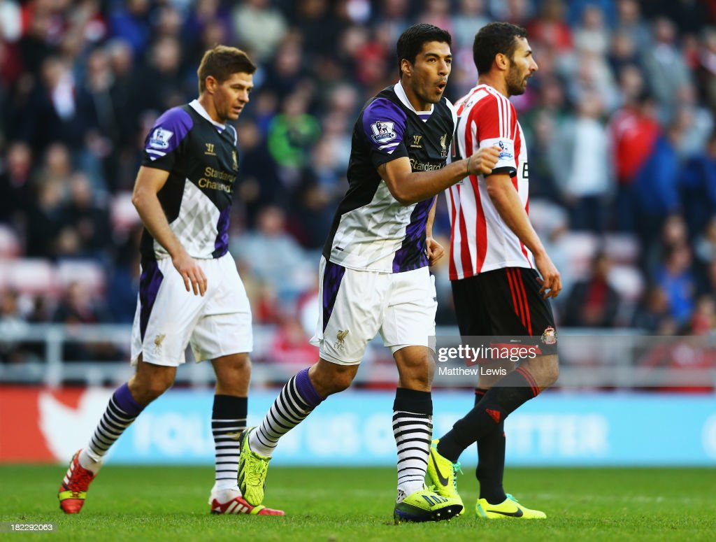 Luis Suarez of Liverpool celebrates his second goal during the Barclays Premier League match between Sunderland and Liverpool at the Stadium of Light on September 29, 2013 in Sunderland, England.