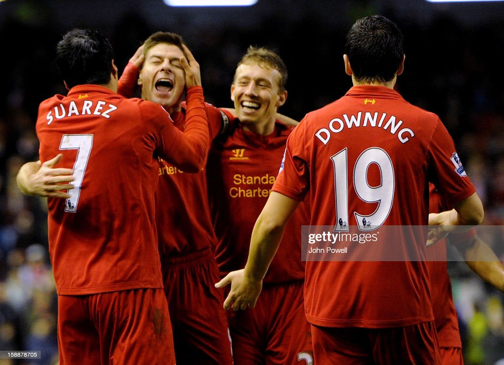 Luis Suarez of Liverpool celebrates his second goal with team mates during the Barclays Premier League match between Liverpool and Sunderland at Anfield on January 2, 2013 in Liverpool, England.