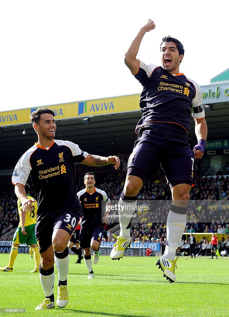 Luis Suarez of Liverpool celebrates next to Jesus Fernandez after scoring the opening goal during the Barclays Premier League match between Norwich City and Liverpool at Carrow Road on September 29, 2012 in Norwich, England.