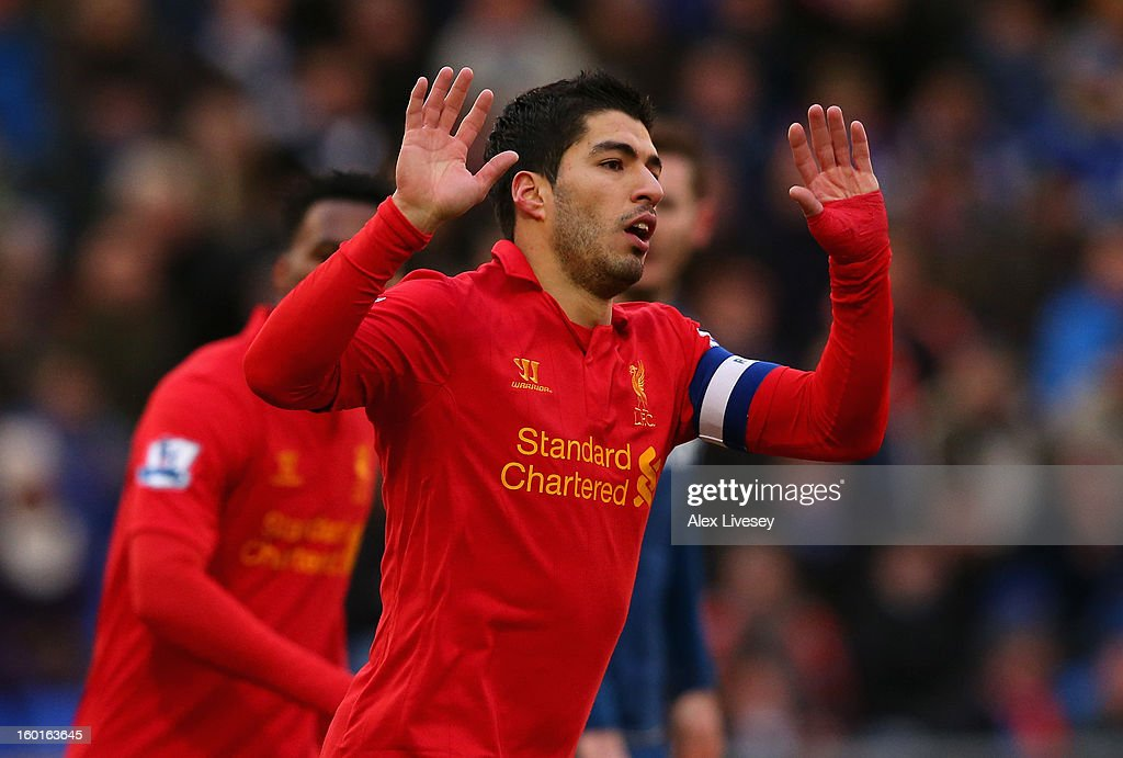 Luis Suarez of Liverpool celebrates scoring his team's first goal during the FA Cup with Budweiser Fourth Round match between Oldham Athletic and Liverpool at Boundary Park on January 27, 2013 in Oldham, England.