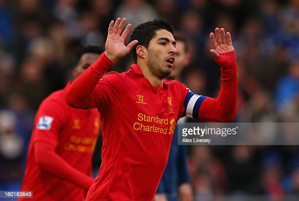Luis Suarez of Liverpool celebrates scoring his team's first goal during the FA Cup with Budweiser Fourth Round match between Oldham Athletic and...