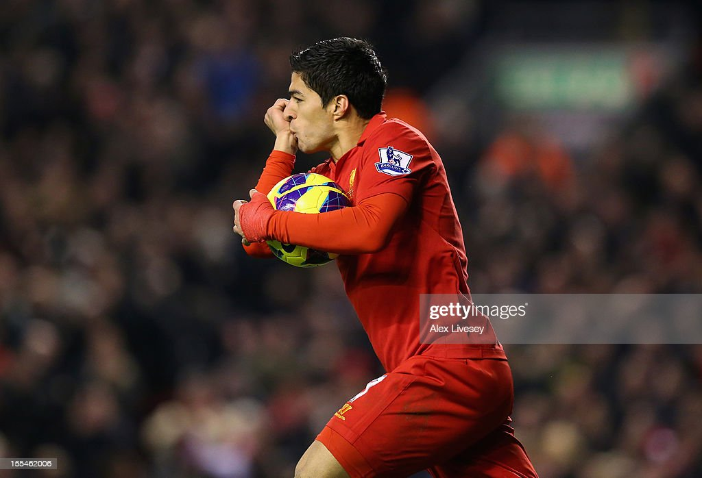 Luis Suarez of Liverpool celebrates scoring his team's first goal to make the score 1-1 during the Barclays Premier League match between Liverpool and Newcastle United at Anfield on November 4, 2012 in Liverpool, England.