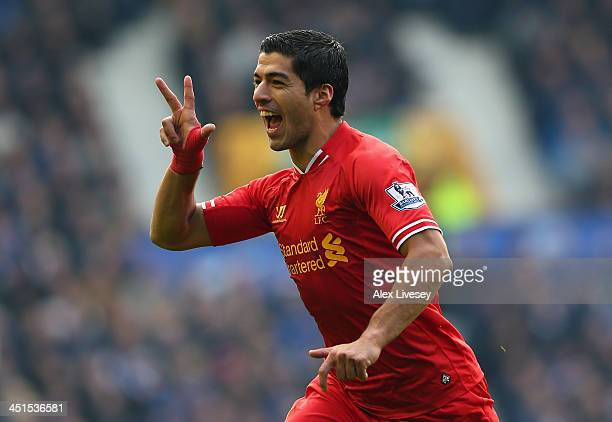 Luis Suarez of Liverpool celebrates scoring his team's second goal during the Barclays Premier League match between Everton and Liverpool at Goodison...
