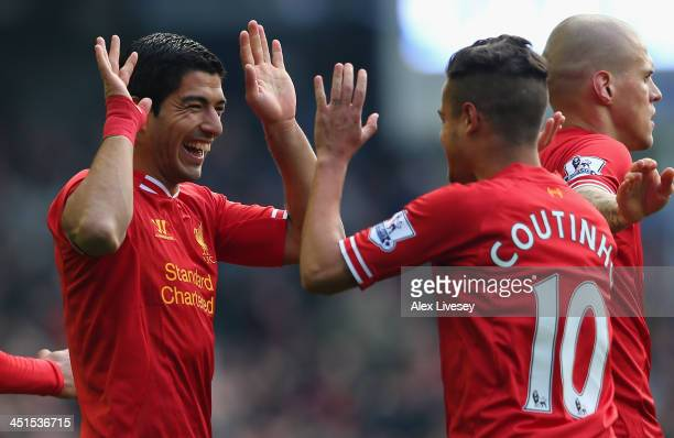 Luis Suarez of Liverpool celebrates scoring his team's second goal with teammate Coutinho during the Barclays Premier League match between Everton...