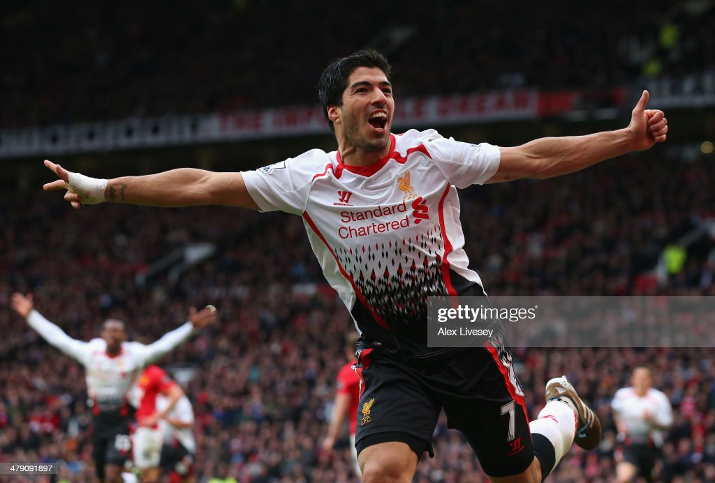 Luis Suarez of Liverpool celebrates scoring his team's third goal during the Barclays Premier League match between Manchester United and Liverpool at Old Trafford on March 16, 2014 in Manchester, England.