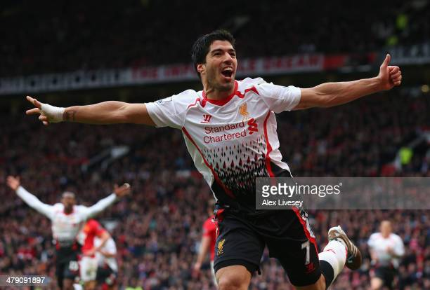 Luis Suarez of Liverpool celebrates scoring his team's third goal during the Barclays Premier League match between Manchester United and Liverpool at...