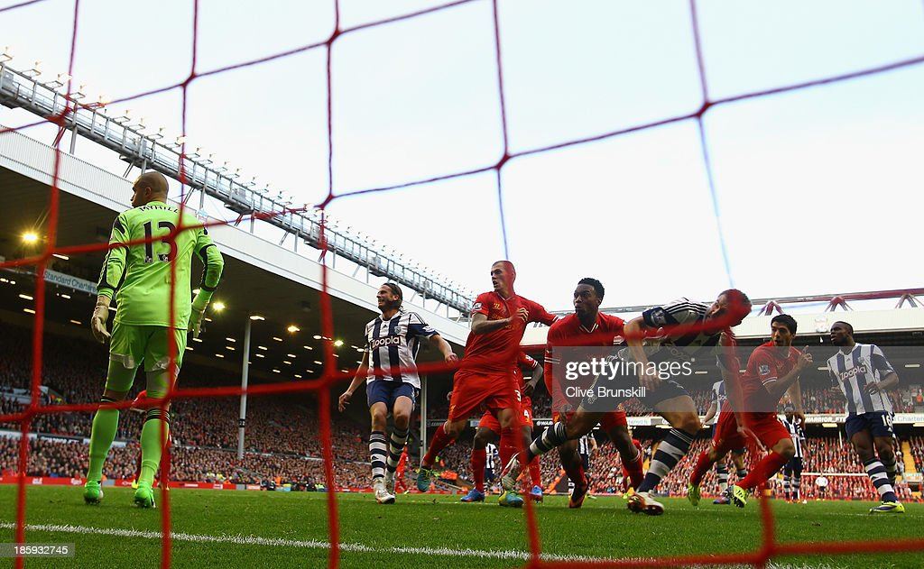Luis Suarez of Liverpool celebrates scoring his team's third goal to complete his hat-trick during the Barclays Premier League match between Liverpool and West Bromwich Albion at Anfield on October 26, 2013 in Liverpool, England.