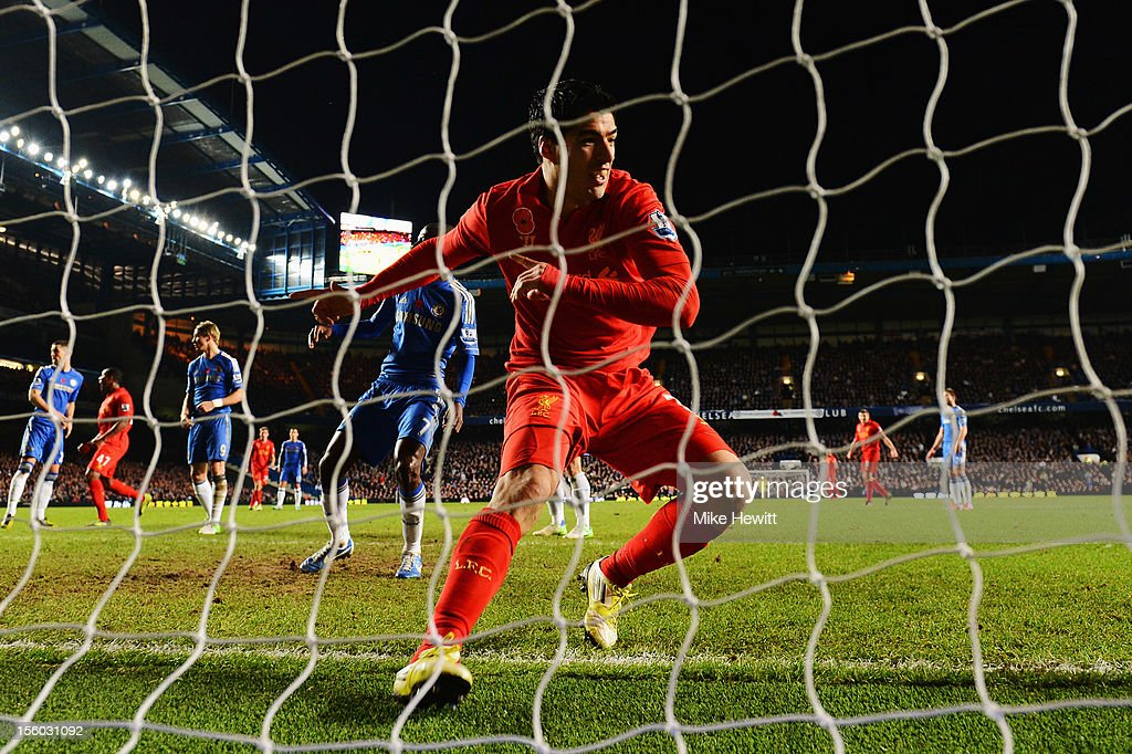 Luis Suarez of Liverpool celebrates scoring the equaliser during the Barclays Premier League match between Chelsea and Liverpool at Stamford Bridge on November 11, 2012 in London, England.