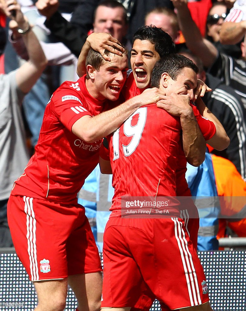 Luis Suarez of Liverpool celebrates scoring the equalising goal with team mates <a gi-track='captionPersonalityLinkClicked' href=/galleries/search?phrase=Jordan+Henderson+-+Soccer+Player&family=editorial&specificpeople=4940390 ng-click='$event.stopPropagation()'>Jordan Henderson</a> (L) and <a gi-track='captionPersonalityLinkClicked' href=/galleries/search?phrase=Stewart+Downing&family=editorial&specificpeople=238961 ng-click='$event.stopPropagation()'>Stewart Downing</a> during the FA Cup with Budweiser Semi Final match between Liverpool and Everton at Wembley Stadium on April 14, 2012 in London, England.