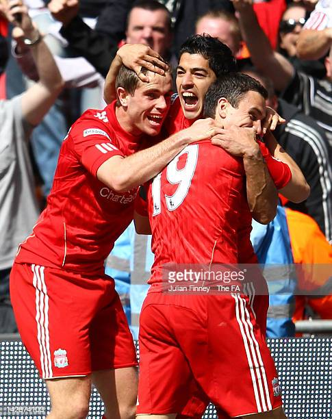 Luis Suarez of Liverpool celebrates scoring the equalising goal with team mates Jordan Henderson and Stewart Downing during the FA Cup with Budweiser...