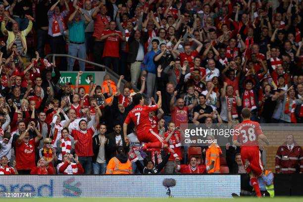 Luis Suarez of Liverpool celebrates scoring the opening goal during the Barclays Premier League match between Liverpool and Sunderland at Anfield on...
