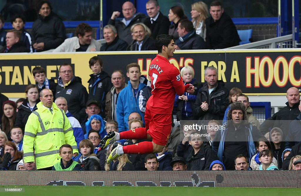 Luis Suarez of Liverpool celebrates scoring the opening goal during the Barclays Premier League match between Everton and Liverpool at Goodison Park on October 28, 2012 in Liverpool, England.