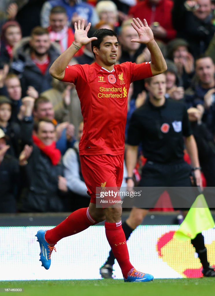 Luis Suarez of Liverpool celebrates scoring the third goal during the Barclays Premier League match between Liverpool and Fulham at Anfield on November 9, 2013 in Liverpool, England.